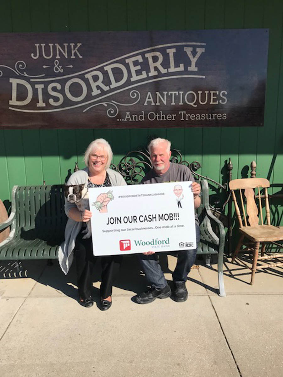 owners of business holding sign that says join our cash mob