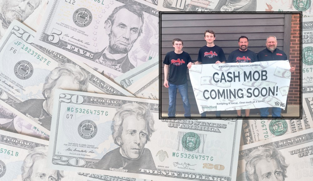 friendly inn employees holding a cash mob coming soon sign