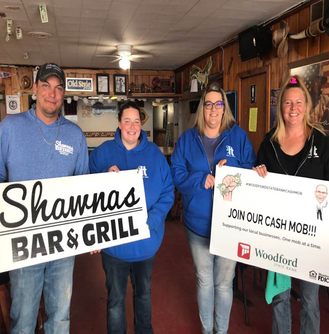 Employees of Shawan's Bar & Grill holding cash mob coming soon sign