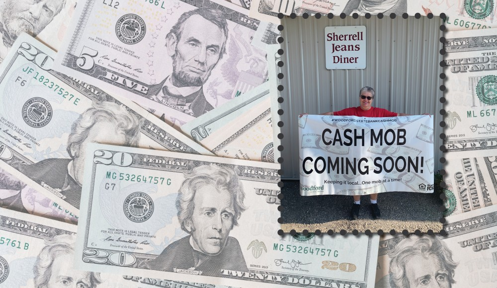 picture of sherrell jeans holding a cash mob sign in front of diner